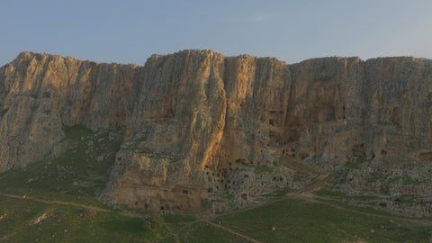 DN4K 009 G Israel stock footage: 4K drone aerial footage of Arbel cliff, drone pulling back