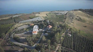 DN002B Aerial drone footage of the Sea of Galilee & Northern Israel: flying above fields, orchards, buildings towards Sea of Galilee