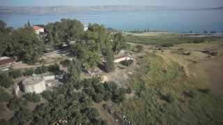 DN003B Aerial drone footage of the Sea of Galilee & Northern Israel: flying above fields, orchards, buildings towards Sea of Galilee