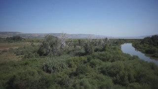 DN006B Aerial drone footage of the Sea of Galilee & Northern Israel: slow right turn revealing Jordan River near Sea of Galilee