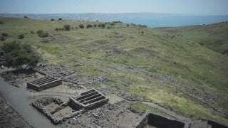 DN008B Aerial drone footage of the Sea of Galilee & Northern Israel: low altitude over Korazim archeological site in Golan Heights