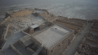 DS005B Aerial drone footage of Masada and the Dead Sea: Masada - top shot from ascending drone