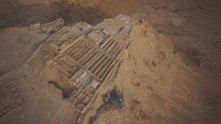 DS040B Aerial drone footage of Masada and the Dead Sea: Dead Sea - hotels in Ein Bokek by the Dead Sea at sunset