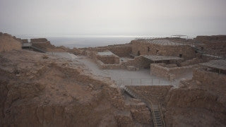 DS022B Aerial drone footage of Masada and the Dead Sea: Judean Desert - dolly in to mountains and creeks
