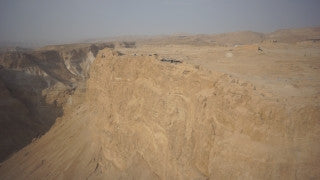 DS007B Aerial drone footage of Masada and the Dead Sea: horizontal flight along Masada top