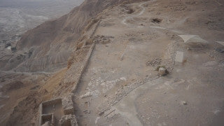 DS008B Aerial drone footage of Masada and the Dead Sea: low altitude horizontal movement looking down at mountain top and archeological site