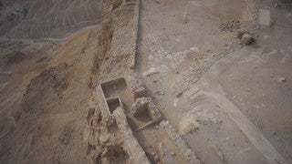 DS010B Aerial drone footage of Masada and the Dead Sea: Masada - horizontal fly back to reveal archeological site