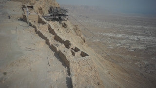 DS011B Aerial drone footage of Masada and the Dead Sea: Masada - looking down at mountain top and snake strail