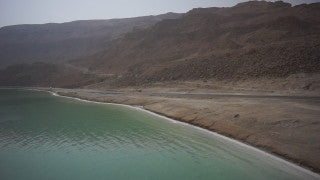 DS012B Aerial drone footage of Masada and the Dead Sea: Dead Sea - low altitude filming north to south along seaside road