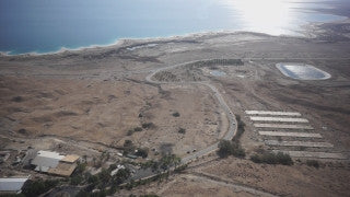 DS016B Aerial drone footage of Masada and the Dead Sea: Ein Gedi - top shot of Kibbutz Ein Gedi, tilt up to Judean Desert and Dead Sea