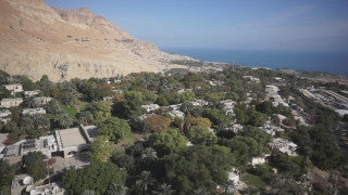 DS018B Aerial drone footage of Masada and the Dead Sea: Fly-by over Kibbutz Ein Gedi