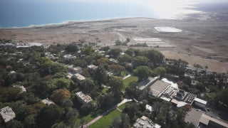 DS019B Aerial drone footage of Masada and the Dead Sea: Ein Gedi - low altitude exposition shot of Kibbutz Ein Gedi