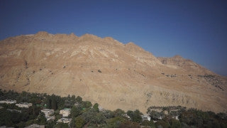 DS020B Aerial drone footage of Masada and the Dead Sea: Ein Gedi - high altitude kibbutz and mountains in background