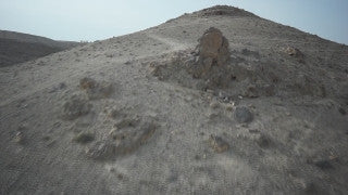 DS024B Aerial drone footage of Masada and the Dead Sea: Judean Desert - low altitude mountains and creeks, forward over mountain to reveal desert landscape