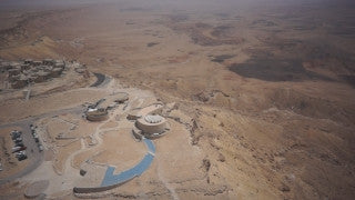 DS049B Aerial drone footage of South Israel and the Negev: plateau in Negev Desert overlooking a deep valley