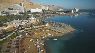 DS035B Aerial drone footage of Masada and the Dead Sea: Dead Sea - hotels south to north along shore