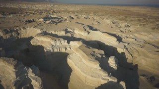 DS044B Aerial drone footage of Masada and the Dead Sea: Sodom near the Dead Sea, vertical climb to expose Dead Sea west coast