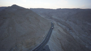 DS048B Aerial drone footage of Masada and the Dead Sea: Israel Road 90, going south to north in Arabah / Arava valley