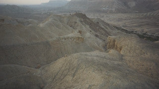 DS053B Aerial drone footage of South Israel and the Negev: low altitude above mountain peaks and deep valleys