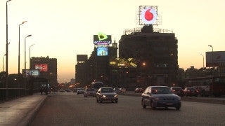 Egypt 027 Egypt Stock Footage: traffic on Nile Palace Bridge