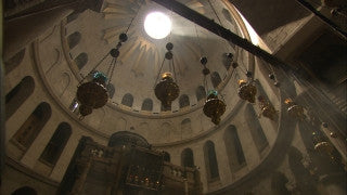 JC_007 - Christian sites in Jerusalem: Church of the Holy Sepulchre, tilt down from ceiling to worshipers on ground level