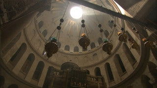 JC_037 - Christian sites in Jerusalem: Old City, Via Dolorosa, pan from building to street with tourists
