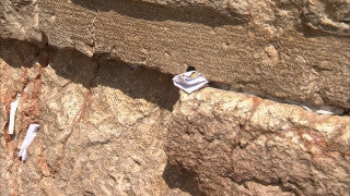 JJ_027 - Jewish sites in Jerusalem: Close up placing a note between stones of the Western Wall