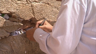 JJ_030 - Jewish sites in Jerusalem: Writing a note at the Western Wall