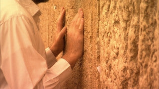 JJ_036 - Jewish sites in Jerusalem: Close up hands of Jewish worshiper at the Western Wall