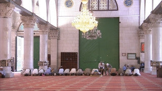 JM_047 - Muslim sites in Jerusalem: Al Aqsa, tight shot of men praying and building architechture