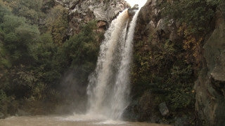 LN_010 Israel Nature and Landscape footage: Tilt down on waterfall in the Galilee Mountains
