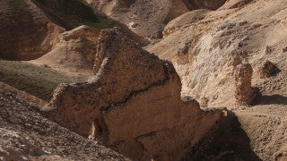 LN_028 Israel Nature and Landscape footage: tilt up over ruins and mountain in the Negev Desert in winter