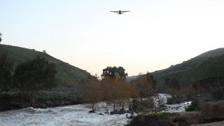 LN_032 Israel Nature and Landscape footage: Jordan River in winter and a small airplane