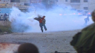 M2_001 Israel military footage: 2nd Intifada - Palestinian demonstrators against Israeli soldiers in A-Ram near Jerusalem