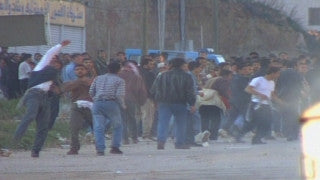 M2_002 Israel military footage: 2nd Intifada - Palestinian demonstrators against Israeli soldiers in A-Ram near Jerusalem