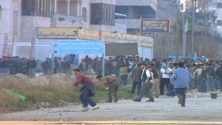 M2_007 Israel military footage: 2nd Intifada - Palestinian demonstrators against Israeli soldiers in A-Ram near Jerusalem