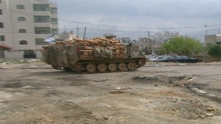 M2_014 Israel military footage: 2nd Intifada - Operation Defensive Shield: Israeli armored carrier in Ramallah April 2002