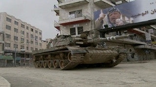 M2_021 Israel military footage: 2nd Intifada - Operation Defensive Shield: Israeli tanks in Ramallah April 2002
