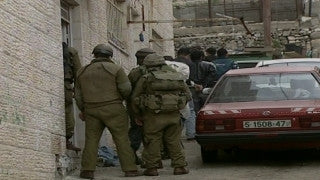 M2_022 Israel military footage: 2nd Intifada - Operation Defensive Shield: IDF soldiers arrest Palestinians in Ramallah April 2002