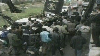 M2_024 Israel military footage: 2nd Intifada - Operation Defensive Shield: funeral of a Palestinian Shahid in Ramallah April 2002