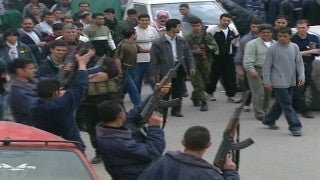 M2_032 Israel military footage: 2nd Intifada - armed Palestinian demonstration in Gaza 2002