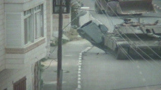 M2_037 Israel military footage: 2nd Intifada - Operation Defensive Shield, Israeli tank runs over a car in Bethlehem, April 2002