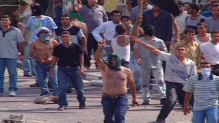 M2_042 Israel military footage: 2nd Intifada - Israeli-Arab demonstration in Um-Al-Fahm, October 2000