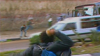 MG_007 Israel military footage: Gaza stock footage - Palestinian children throw stones at Israeli soldiers, 1998