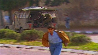 MG_002 Israel military footage: Gaza stock footage - Palestinians throw stones at military jeep, soldiers return fire, 1998