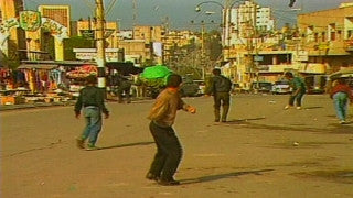 MG_007 Israel military footage: Gaza stock footage - Palestinian children throw stones at Israeli soldiers, 1988