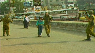 MG_012 Israel military footage: Gaza stock footage - Palestinian child is arrested by an Israeli soldier in Gaza, 1998