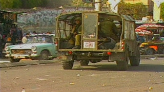 MG_015 Israel military footage: Gaza stock footage - Israeli soldiers in a military vehicle are stoned in central Gaza, 1998