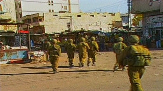 MG_018 Israel military footage: Gaza stock footage - Israeli soldiers patrol at Gaza market, 1998
