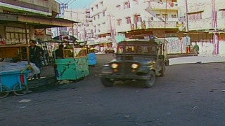 MG_019 Israel military footage: Gaza stock footage - Israeli military jeeps speed through Gaza streets, 1998